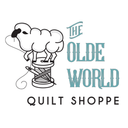 The Olde World Quilt Shoppe Logo